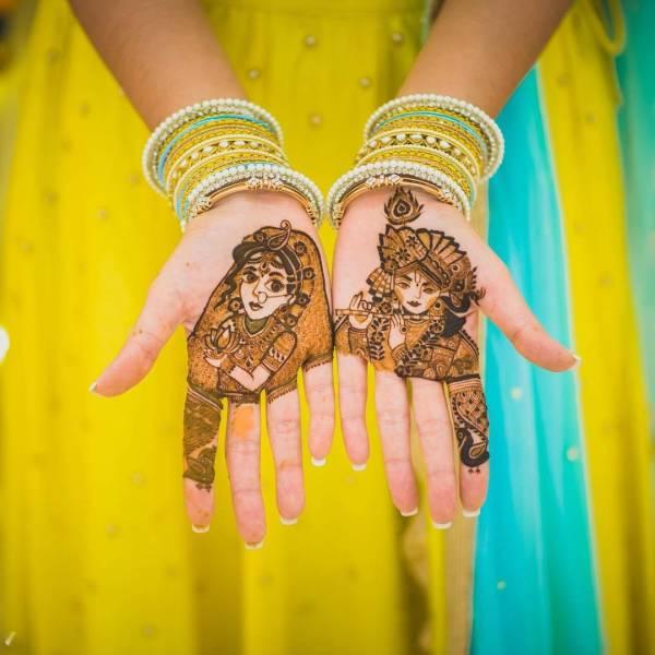 Dulhan mehndi designs for hands- Krishna and Radha mehndi design