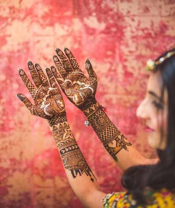 new bridal mehndi designs for full hands - with love story on arms - Masoom Minawala blogger wedding