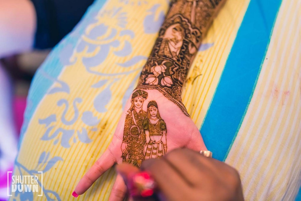 New mehndi design- Bride and Groom portrait on mehndi