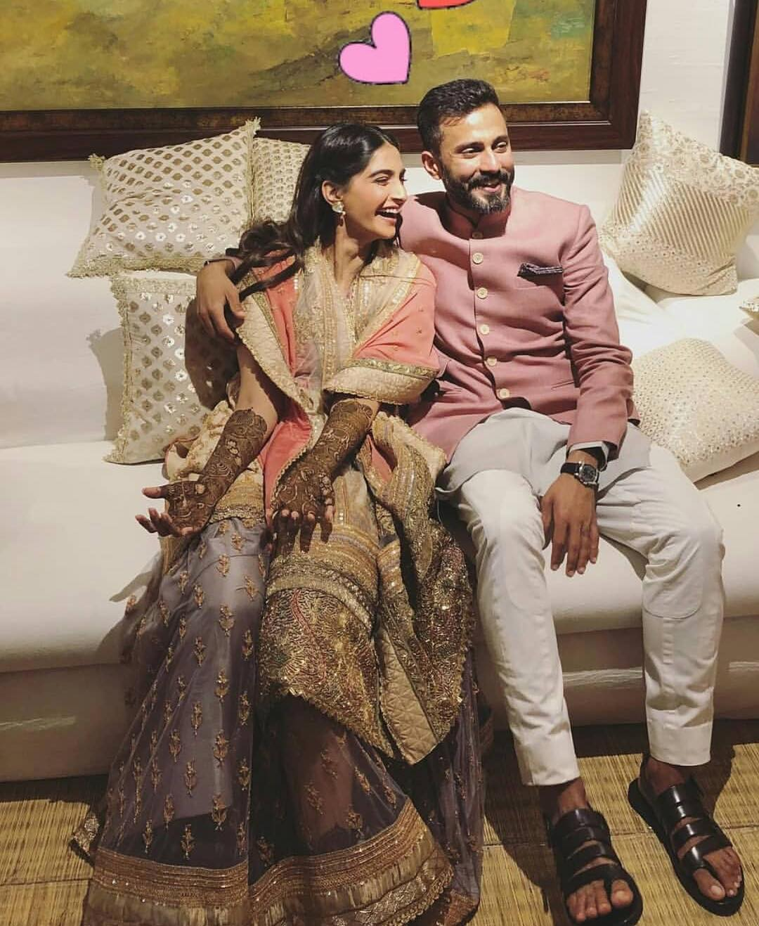 Sonam Kapoor on her Mehendi Function with the Groom - Anand Ahuja wearing a Rose Pink Sherwani by Raghavendra Rathore
