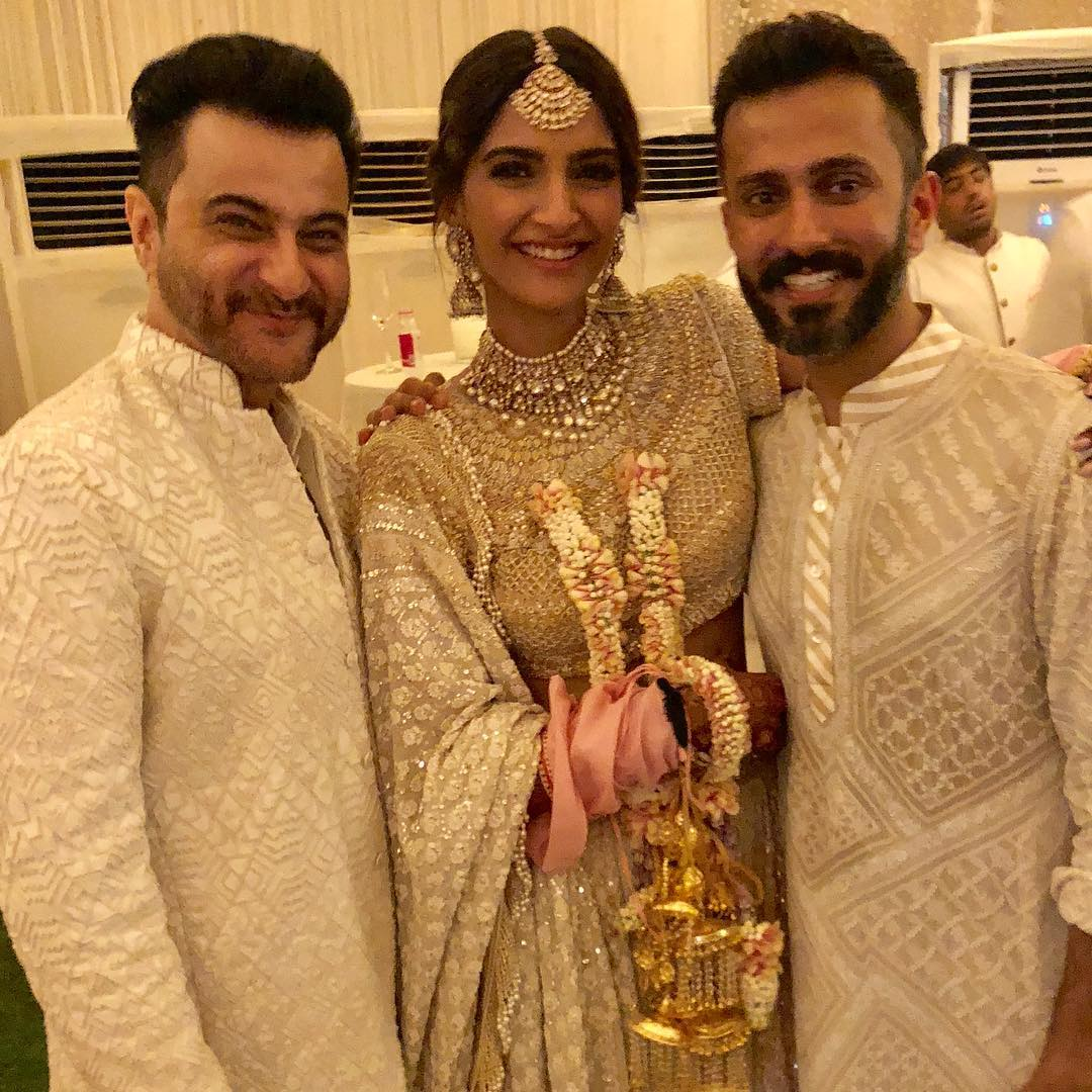 Sonam Kapoor's Mehendi Function- pastel lehenga by Abu Jani Sandeep Khosla, groom- a jacket on kurta