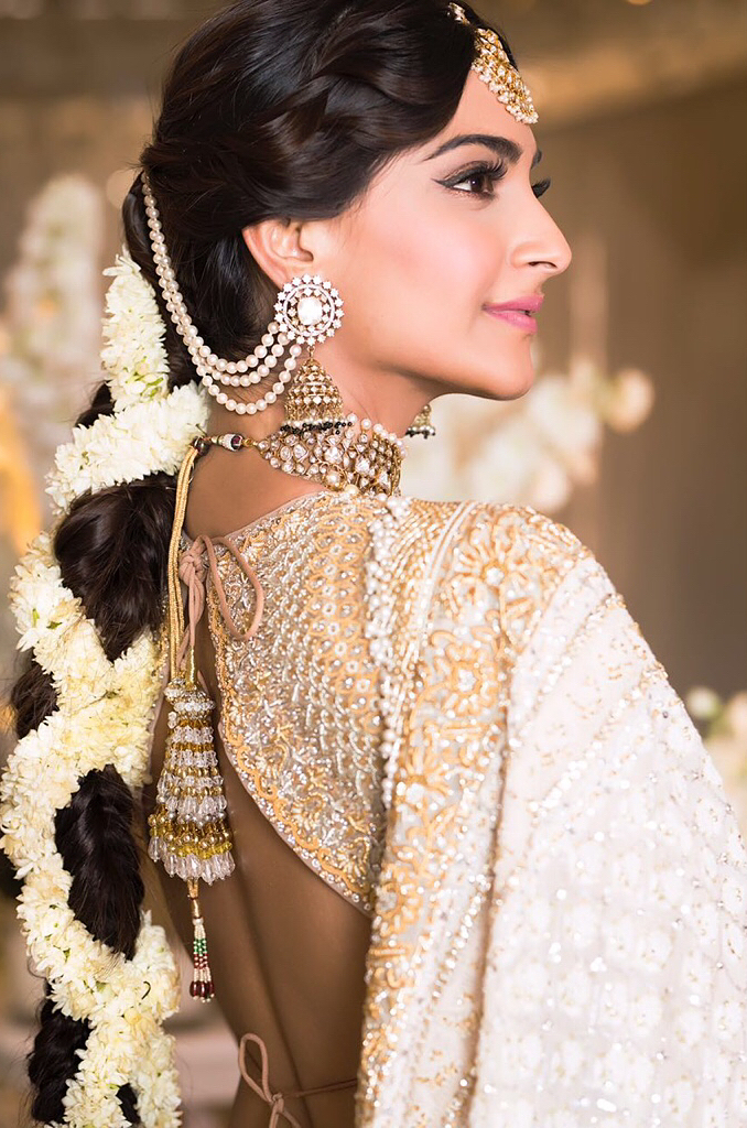 Sonam Kapoor's Mehendi function Makeup and Hairstyle by Namrata Soni- winged eyeliner look with braid and flowers