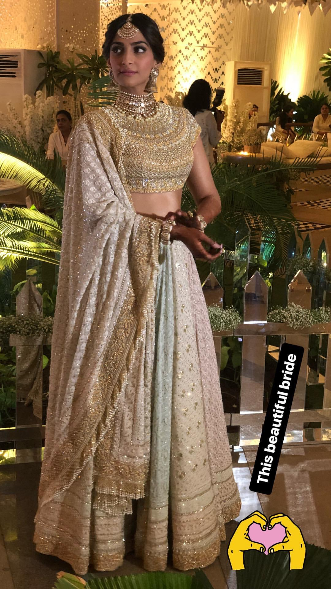 Sonam Kapoor's Mehendi Function Outfit- Pastel coloured Multi-Panelled Lehenga by Abu Jani Sandeep Khosla