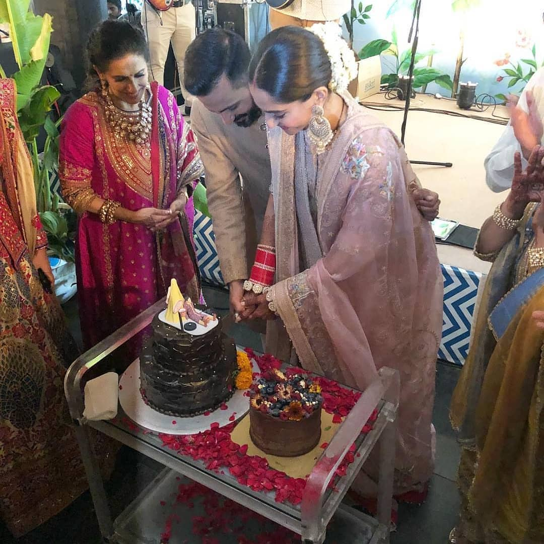 Sonam Kapoor's wedding lehenga after the main ceremony by Anamika Khanna and cake by Le15 Patisserie