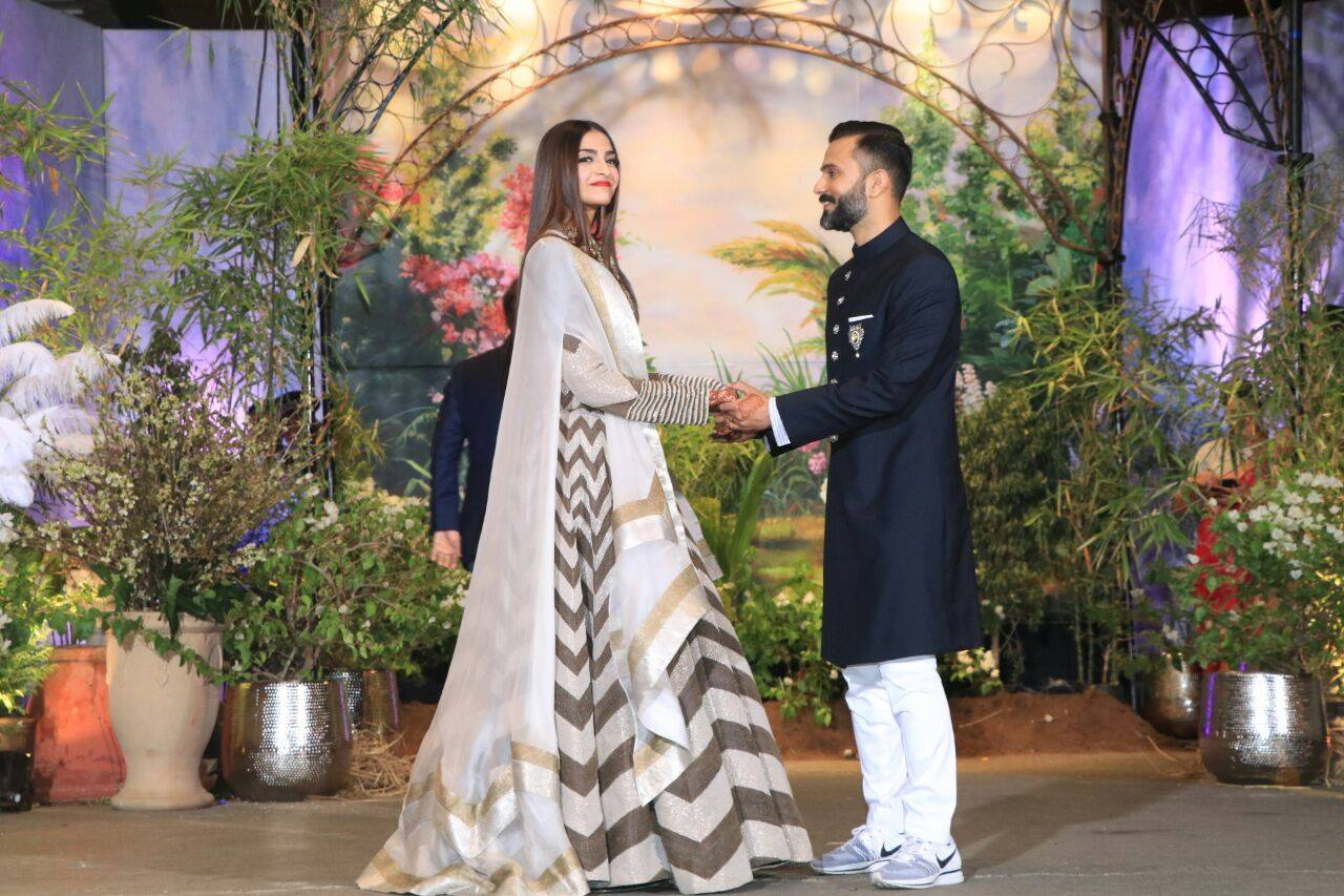 Sonam Kapoor's wedding reception- Grey and silver Lehenga by Anamika Khanna, Anand Ahuja's Sherwani by Raghuvanshi Rathorewith sneakers.