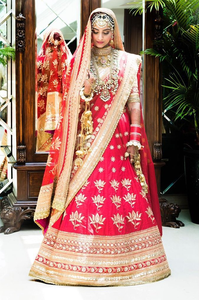 Sonam Kapoor's red and gold wedding lehenga by Anuradha Vakil