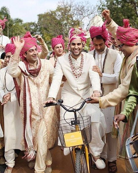Groom entry in Indian Wedding - on a bicycle
