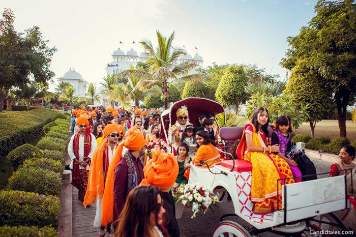 Indian wedding groom entrance in golf cart with baraat