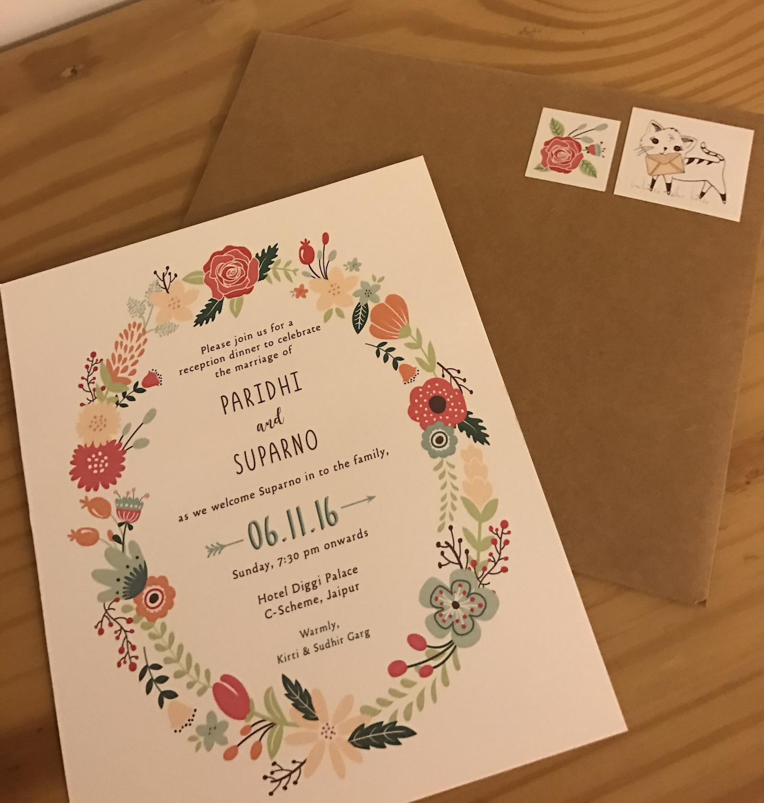 Floral wreath illustrations on unique Indian wedding invitation