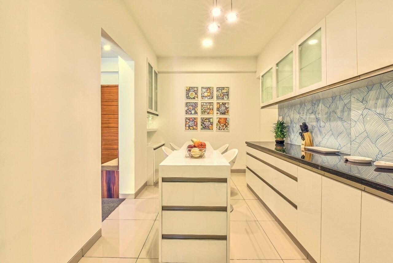 White kitchen with island and blue backsplash