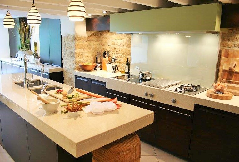 Single wall kitchen with parallel island sink