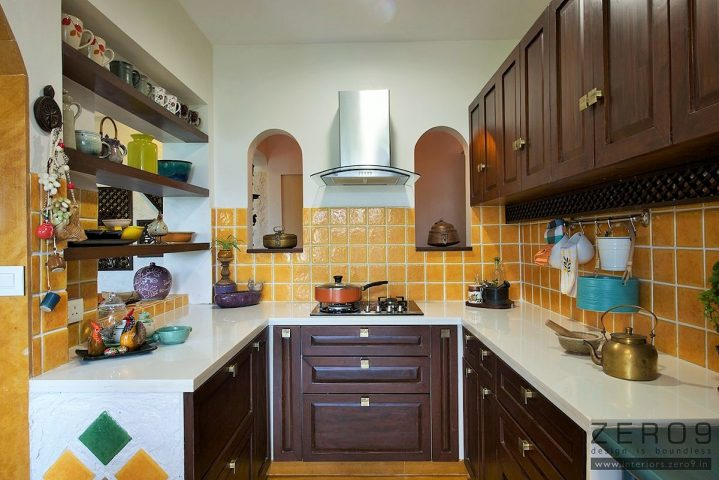 U-shaped kitchen with dark walnut wooden cabinets and yellow backsplash