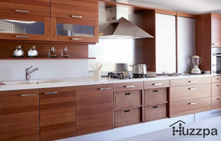 Kitchen with wooden cabinets and pull-out baskets