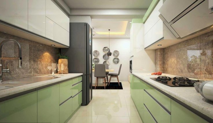 Parallel kitchen with green and white cabinets and marble countertop
