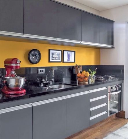 Modern grey and yellow kitchen with handleless cabinets