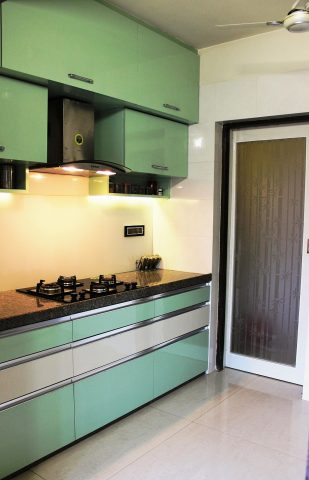 Green modular kitchen with horizontal cabinets and granite countertop
