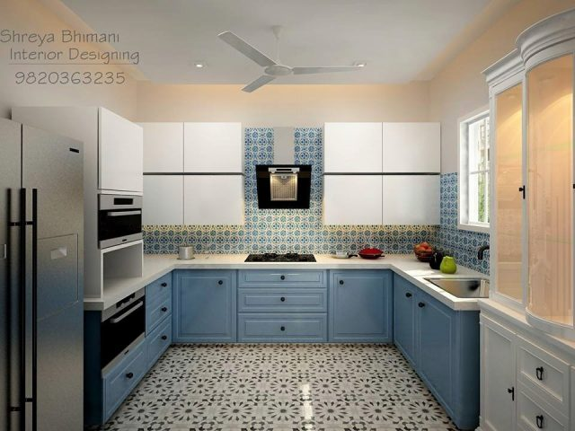 U-shaped kitchen with blue cabinets and patterned flooring and backsplash
