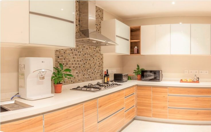 White and brown themed L-shaped kitchen