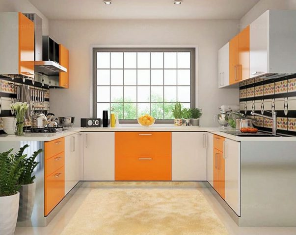 U-shaped kitchen with orange and white cabinets and large window