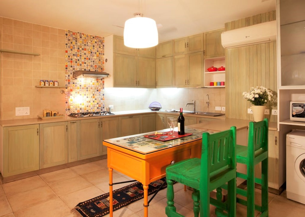 Kitchen with colourful breakfast peninsula