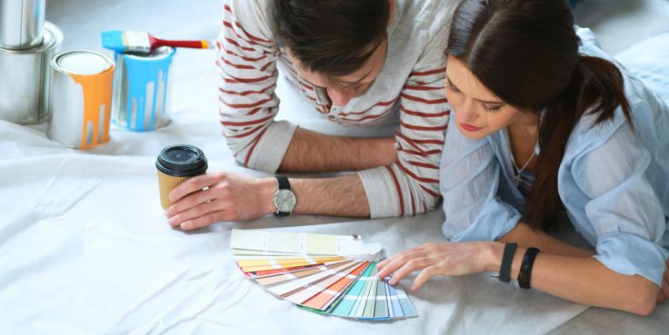 couple picking wall paint colours for their home