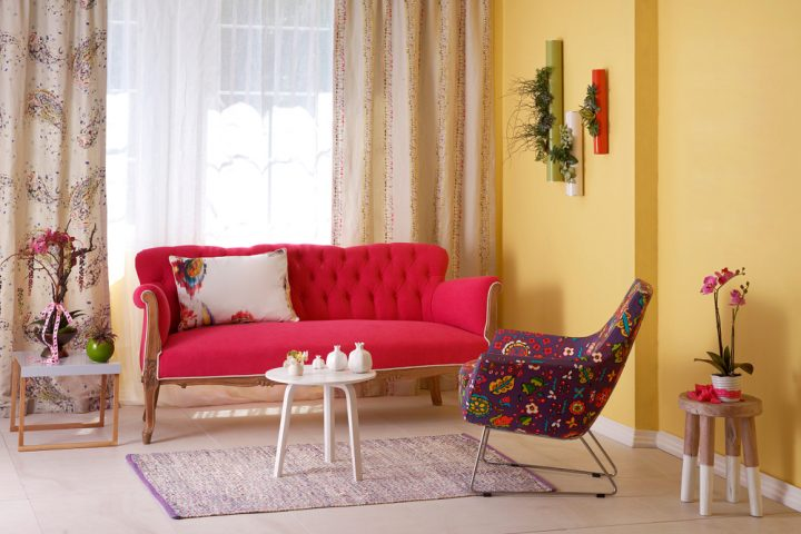hot pink sofa and quirky chair in living room