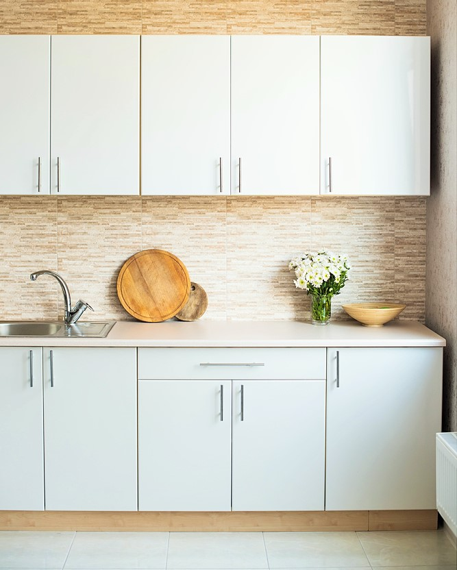 neutral coloured cabinets in a small kitchen