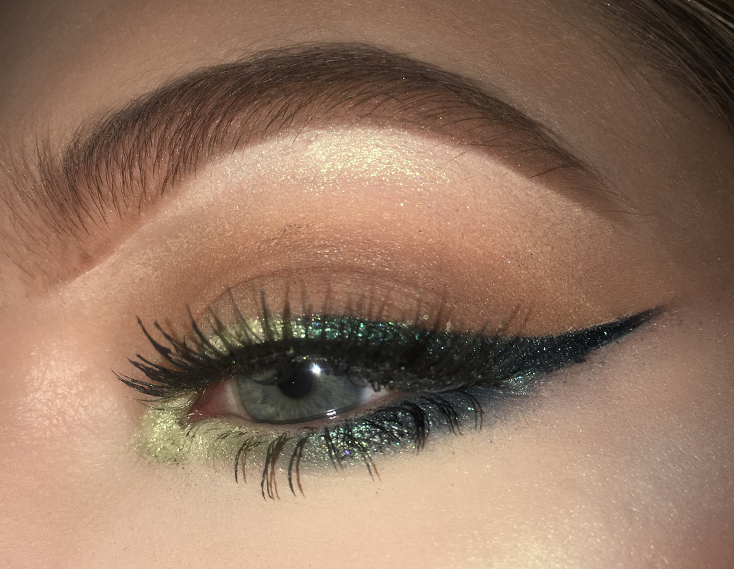 light green colored eyeliner with dark green