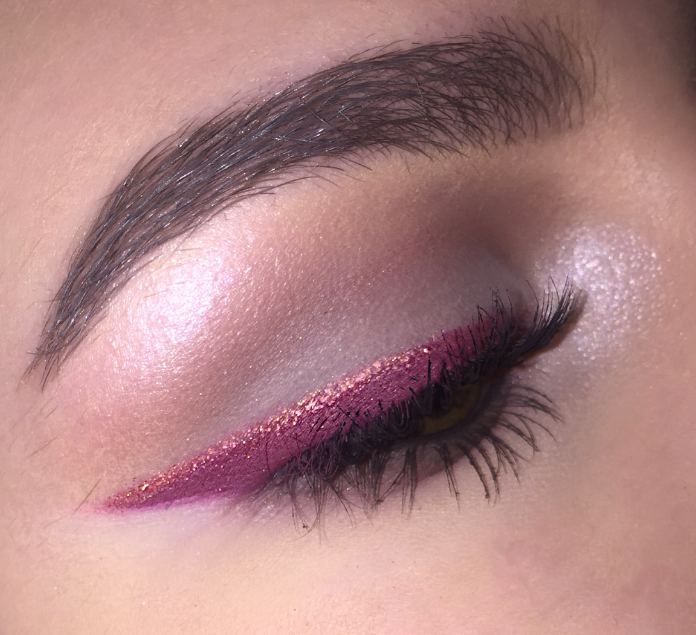 Pink glitter eyeliner over mauve eyeliner for a soft yet glam look