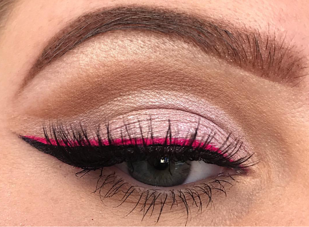 Hot pink colored eyeliner on black liner