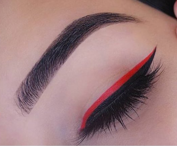 Bright red colored eyeliner on black liner