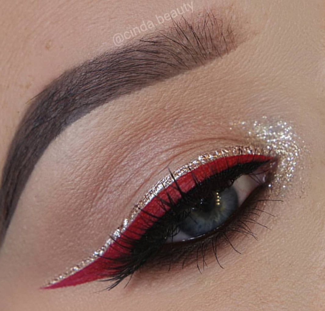 silver eyeliner paired with red colored eyeliner