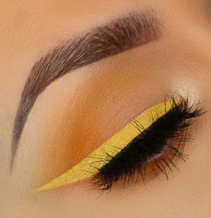 Yellow colored eyeliner for winged liner look