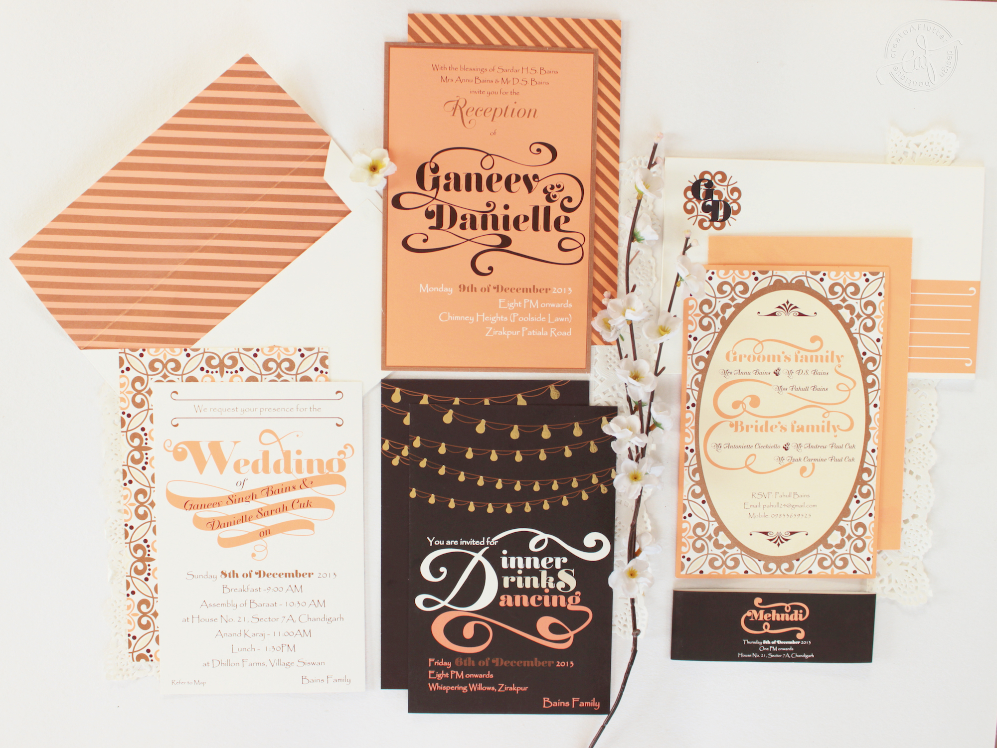 wedding cards design india - unique peach and brown colour palette with filament bulbs, gorgeous font and striped envelope liner