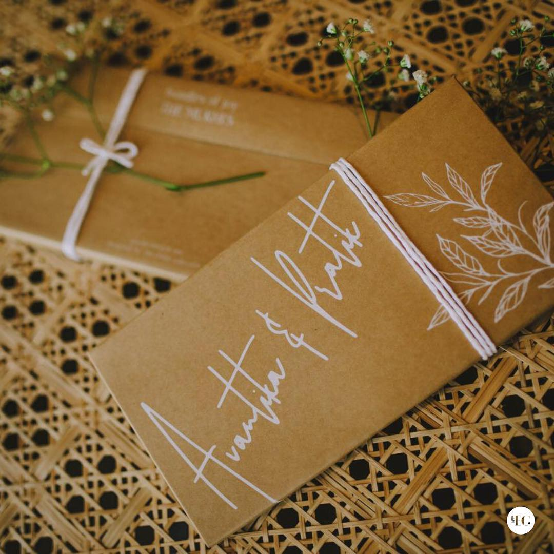 recycled brown paper envelope for save the date wedding invite with white lettering