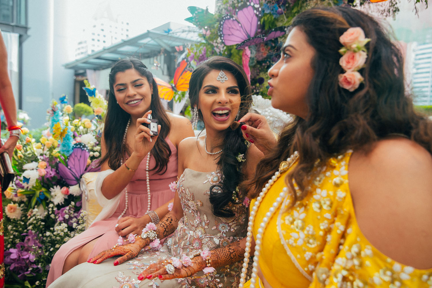 Indian bride at her Thailand destination wedding wearing a delicate diamond maang tikka with a gown on her Mehendi ceremony