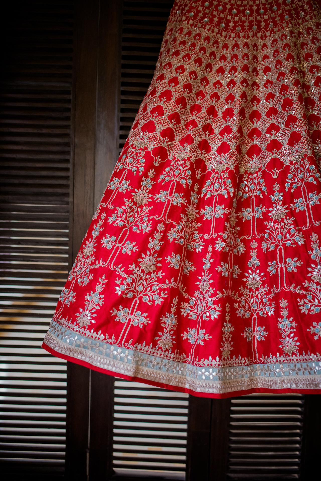 Gota patti red wedding lehenga by Anity Dongre