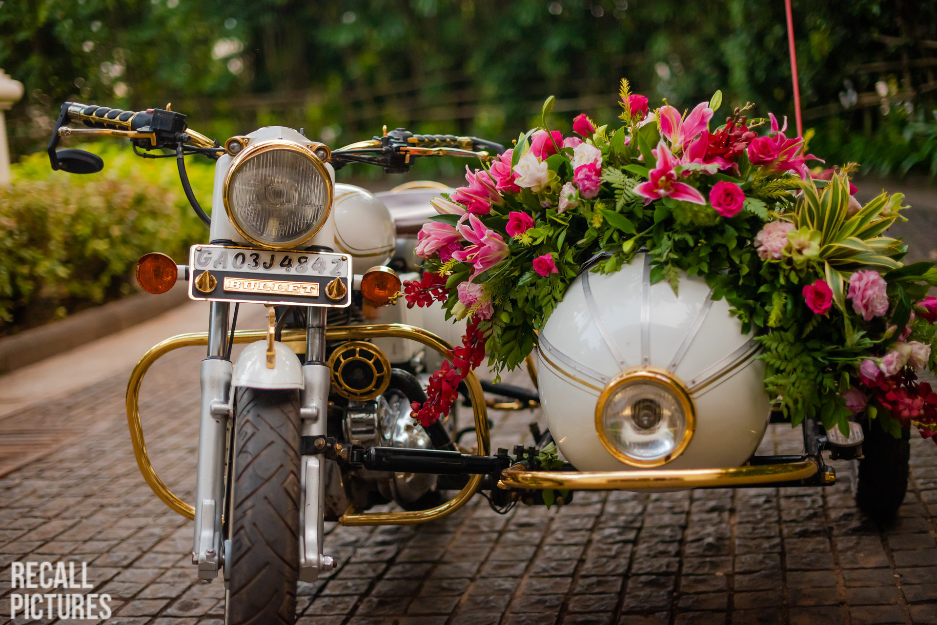 decor for antique motorcycle - groom entry idea