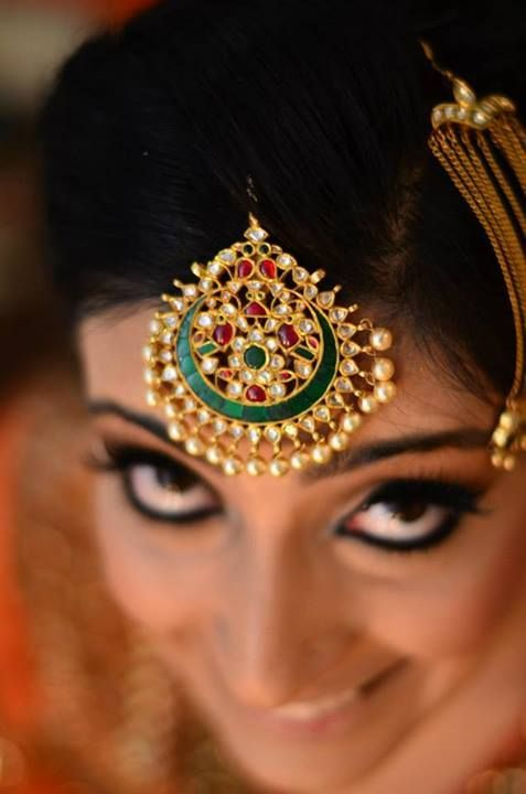 punjabi maang tikka with red and green stones on a Chandigarh bride