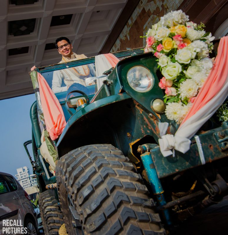 Indian wedding groom entrance on a jeep