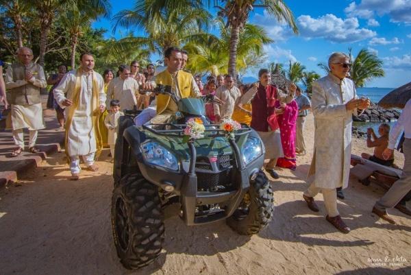 cool groom entrance idea - on ATV for beach wedding on the sand