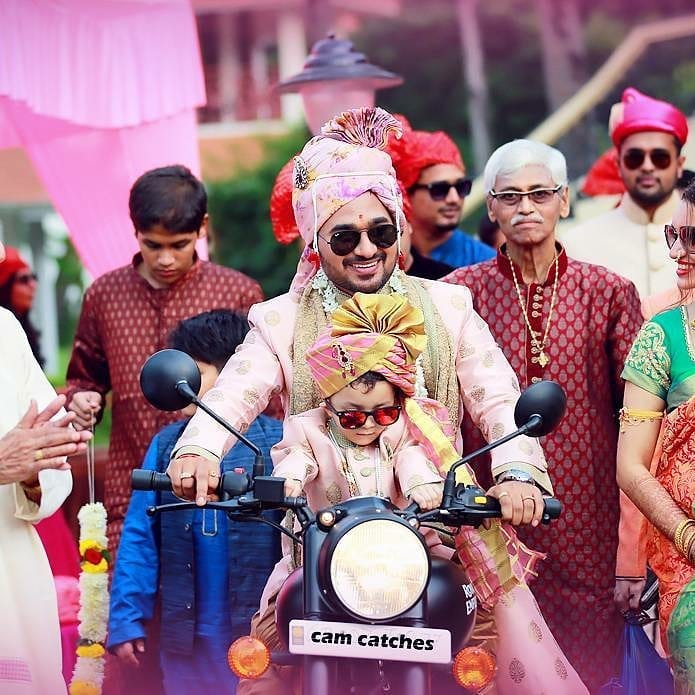 groom entry in Indian wedding on a bike