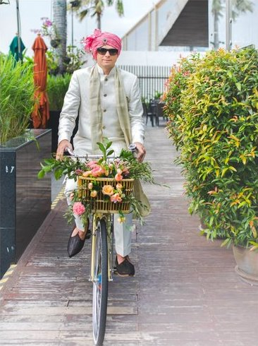 Groom entry in Indian Wedding - on a bicycle with a flower basket in front