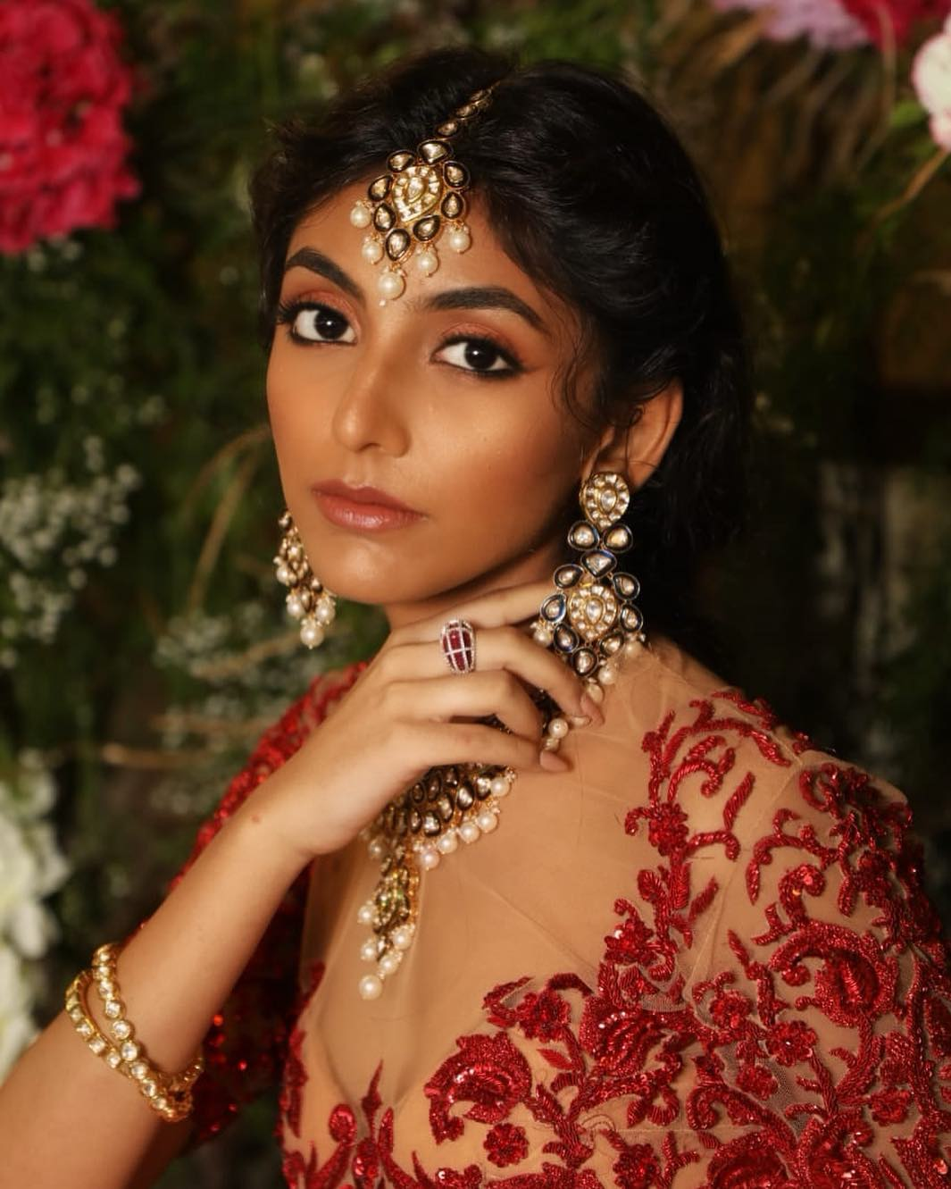 wedding makeup for dark skin for reception function - bride is wearing reddish nude lipstick with copper reddish eye shadow