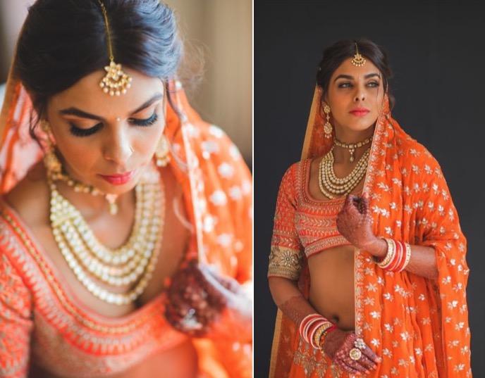 day wedding makeup for dark skin - bride is wearing orange lehanga with orange lipstick and shades of orange as eye shadow