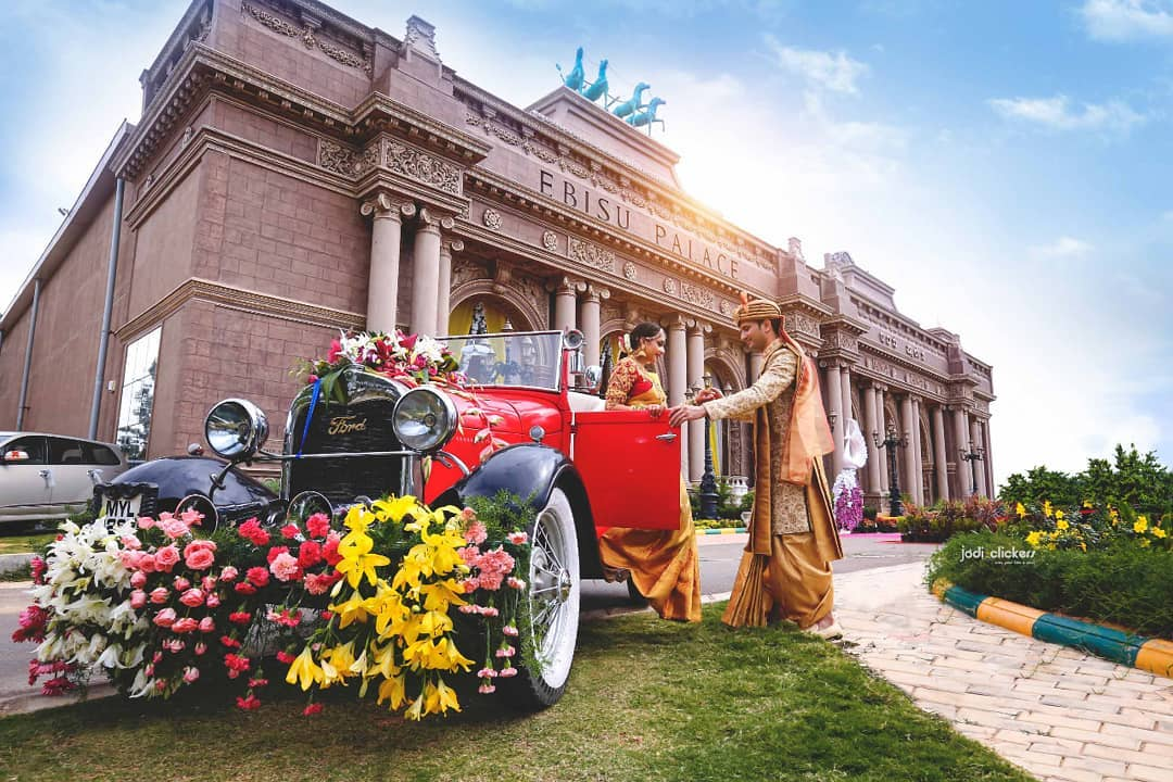 Bride entry in marriage Indian - in decorated vintage car