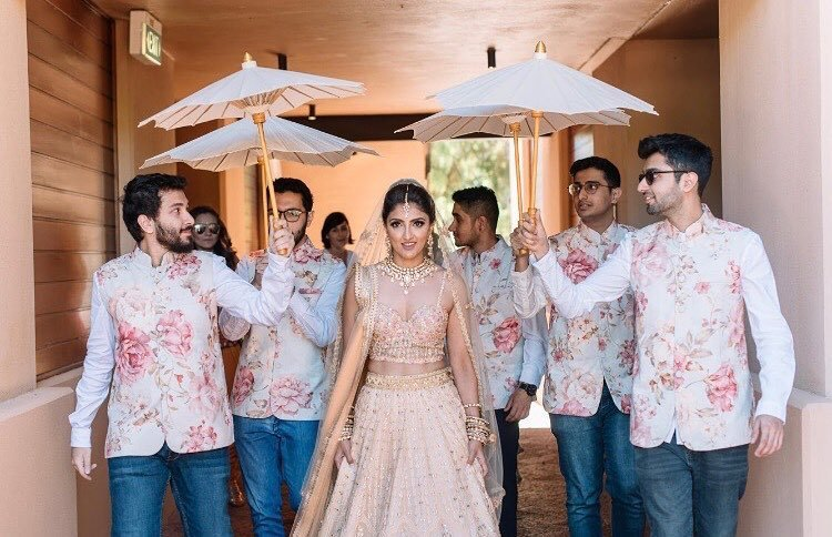 Wedding entry idea for bride - under paper umbrellas held by brothers - no phoolon ki chadar idea
