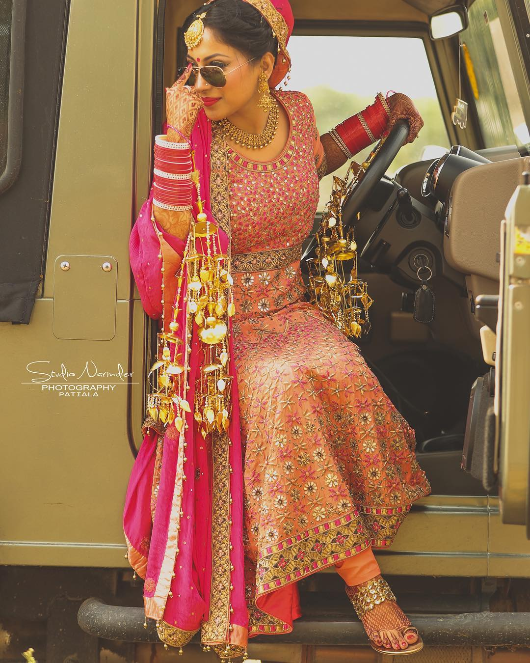 Entry of bride in Indian wedding - driving a jeep