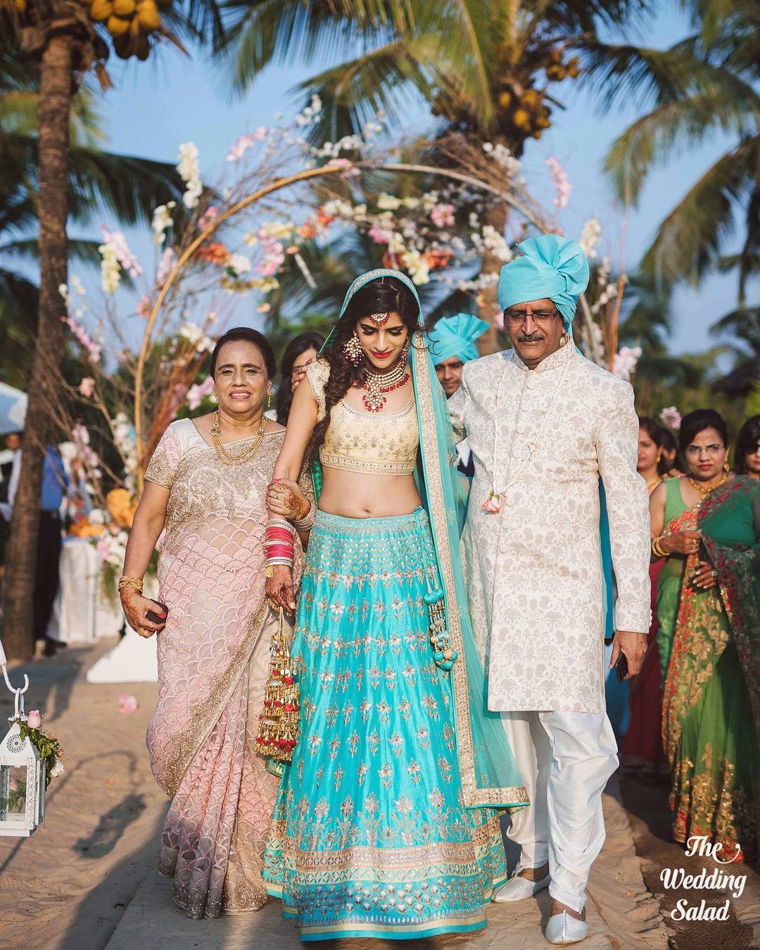 Best bride entry - with both her parents and father wearing safa in same shade as her lehenga
