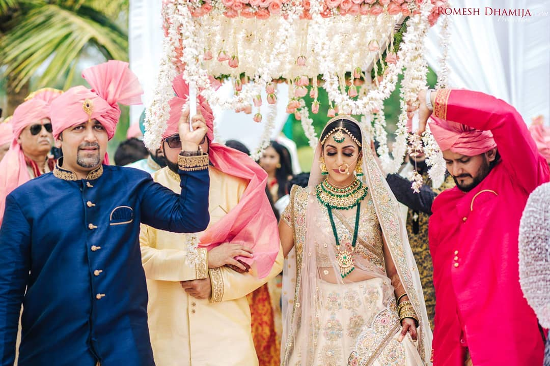 Indian bride entry ideas - walk under phoolon ki chadar with brother of the bride